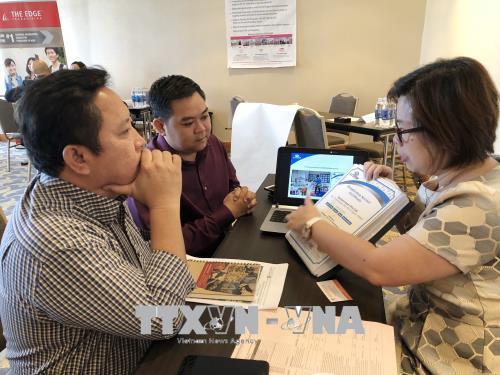 Trong ảnh: Các công ty nước ngoài chia sẻ thông tin thương hiệu nhượng quyền vào thị trường Việt Nam. Ảnh: Mỹ Phương - TTXVN