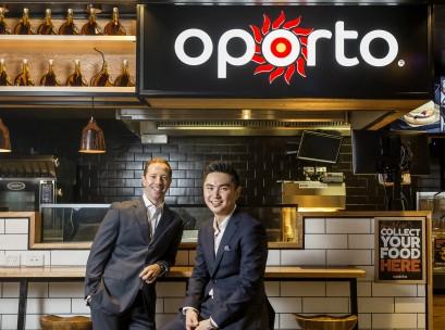 Oporto's Craig Tozer with Aura Group's MD Calvin Ng