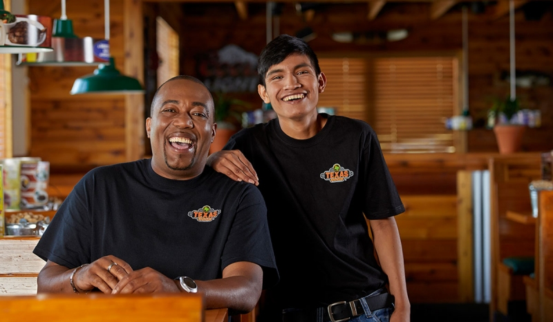 TEXAS ROADHOUSE Texas Roadhouse cultivates a team culture within its restaurants, even holding line-dancing contests.
