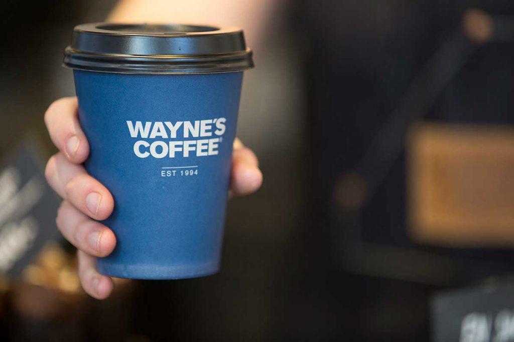 What factors should I consider when choosing a café brand?
